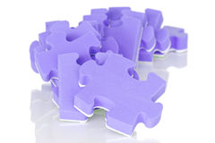 Pile of purple puzzle Royalty Free Stock Photos