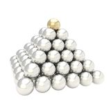 Pile pyramid of glossy spheres isolated on white. Leadership conception as pile pyramid of glossy silver chrome spheres with one golden at the top, isolated on Royalty Free Stock Images