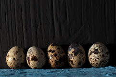 A pile of quail eggs against black background close up. A pile of quail eggs against black background Stock Image