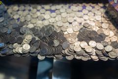 Pile of quarter coins inside the gamble machine stock photos