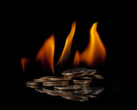 Pile of Quarters on Fire Stock Photo