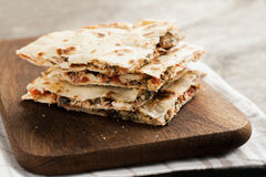 Pile of quesadillas with chicken and vegetables on the rustic bo royalty free stock photo