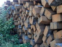Pile of  railway sleepers. Pile of old railway sleepers dropped in a field Royalty Free Stock Photo