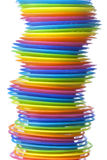 Pile of rainbow colored plastic dishes Stock Photos