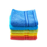 Pile of rainbow colored towels isolated Stock Photos