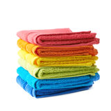 Pile of rainbow colored towels isolated Royalty Free Stock Image