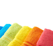 Pile of rainbow colored towels isolated Royalty Free Stock Photos