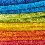 Pile of rainbow colored towels Royalty Free Stock Photography