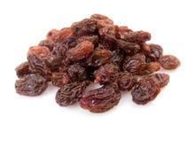 Pile of raisins. Isolated on white background Royalty Free Stock Photo