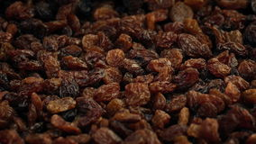 Lots of raisins rotating. Pile of raisins turning slowly