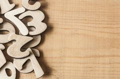 Pile random numbers on wooden table. Closeup image with pile numbers on wooden table Royalty Free Stock Photos