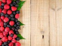 Pile of raspberry on wood Stock Photos