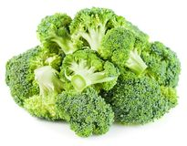 Pile of raw broccoli vegetable isolated stock photo