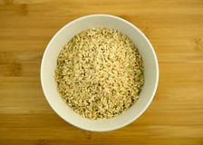 Pile of raw brown rice in a white bowl Royalty Free Stock Photos