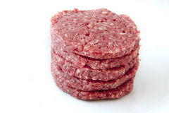 Raw burgers on a white background Stock Photography
