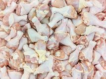 Closeup pile of raw chicken drumstick for cook textured background. Pile of raw chicken drumstick for cook textured background Royalty Free Stock Images