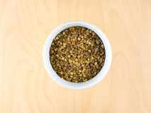 Pile of raw dry brown lentils in cup, top center. Pile of raw dry brown lentils in cup, top view, center composition, food preparation, copy space Stock Photography