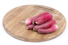 Pile of raw fresh red radishes on the wooden board.  Stock Photography