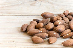 Pile of raw hazelnuts on rustic wooden table Royalty Free Stock Image