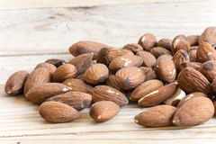 Pile of raw hazelnuts on rustic wooden table Stock Images
