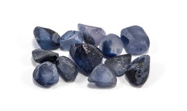 Pile of raw natural ble sapphires. On white background Stock Photo