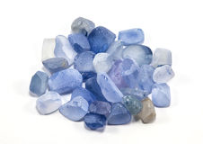 Pile of raw natural ble sapphires. On white background Royalty Free Stock Photo