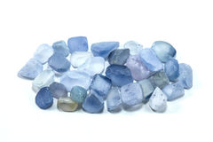 Pile of raw natural ble sapphires. On white background Stock Image