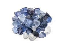 Pile of raw natural ble sapphires. On white background Royalty Free Stock Photography
