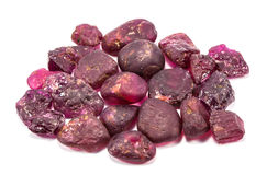 Pile of raw natural ruby. On white background Stock Photo