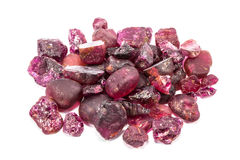 Pile of raw natural ruby. On white background Stock Images
