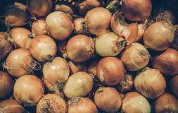 Pile of raw onions on sales in the outdoor grocery market of Tha Stock Photo