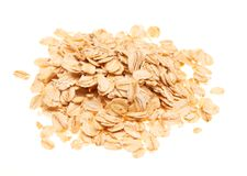 Pile of raw organic oatmeal flakes. Isolated on the white background Stock Images
