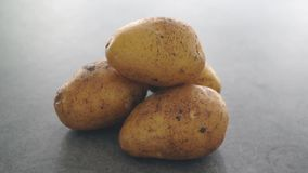 Pile raw potatoes rotating. Slow motion footage video stock video footage