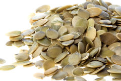 Pile of Raw Pumpkin Seeds. Stack of fresh raw pumpkin seeds on white Royalty Free Stock Photos