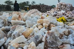 Pile of raw rock salt chunks stock images