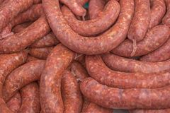 Pile of raw sausages ready to cook or grill. Shallow focus Royalty Free Stock Photography