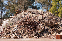 Pile of raw timber for recycling. At waste depot Royalty Free Stock Photo