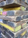 A pile of rectangle woods. Stacked rectangle woods with yellow background Stock Photography