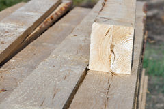 Pile of rectangular wooden beams in the construction site. Stock Images