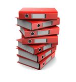 Pile of red binder folders Royalty Free Stock Photo
