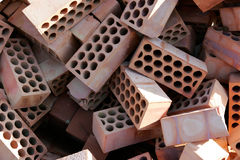 Pile of red bricks with cirlces or holes Stock Image