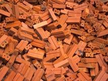 Pile of red bricks Stock Photos