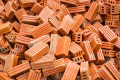 Pile of red bricks with horizontal lines Royalty Free Stock Photos