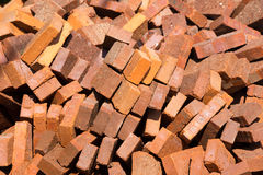 Pile of red bricks outside in the sun Stock Images