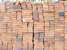 A pile of red new bricks wall Royalty Free Stock Images