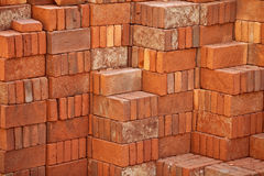 Pile of red bricks prepared for building Stock Image