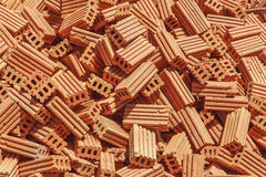 Pile of red bricks texture background Stock Photography