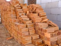 Pile of red bricks which is prepared for construction. royalty free stock image