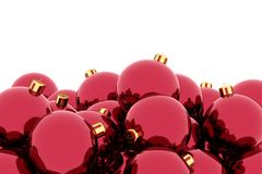 Pile of red Christmas balls against white Royalty Free Stock Images