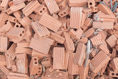 Pile of red clay brick. Royalty Free Stock Photo